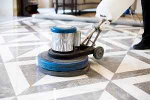 bigstock man polishing marble floor in